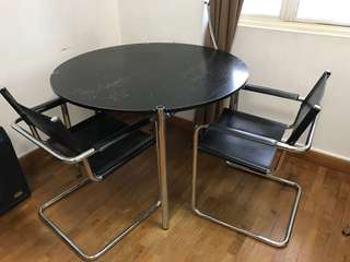 Black round table with chrome legs