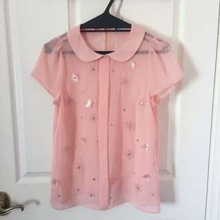 Pink top with floral detailing