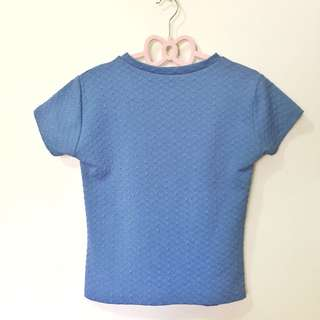 blue high neck crop top with embossed pattern