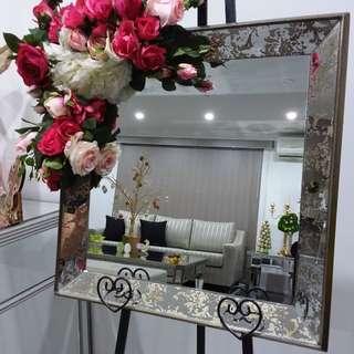Mirror with silk flowers