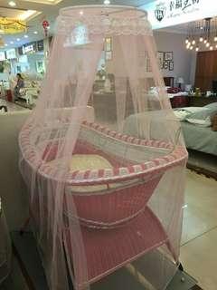 Musical Rattan Baby Cradle
