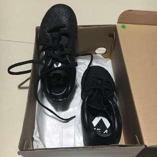 Boy's Adidas soccer shoes