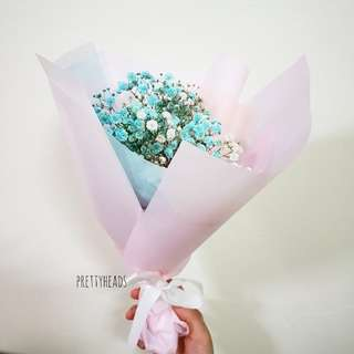 Pastel circular wrapped baby breath flower bouquet