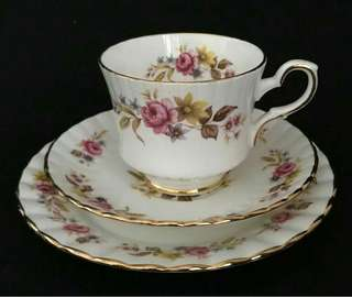 Vintage tea cup , saucer and side plate