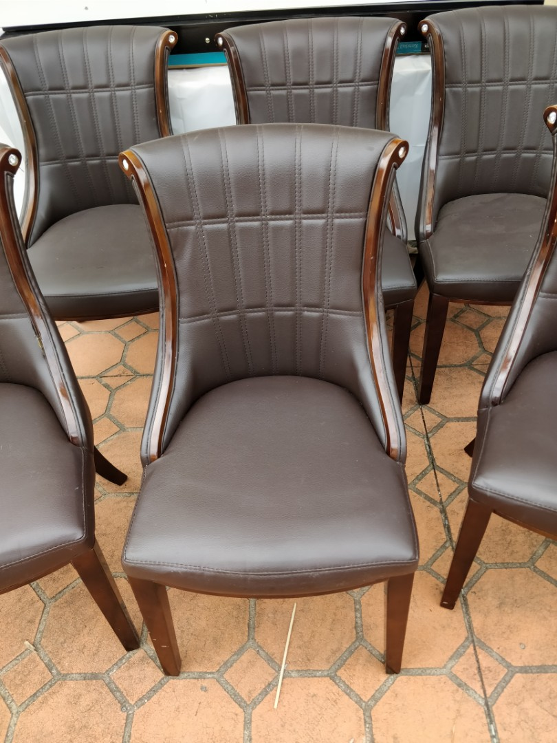 Elegant brown faux leather chairs