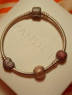 Pandora bracelet with charms.
