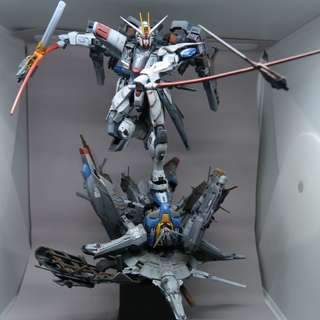 Painted built freedom and providence gundam diorama.