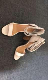Nude stroppy heels