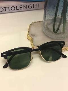 Black Sunglasses with Gold Trim
