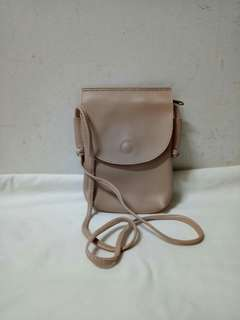 Dolly leather sling bag