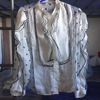 Ruffled formal sheer top