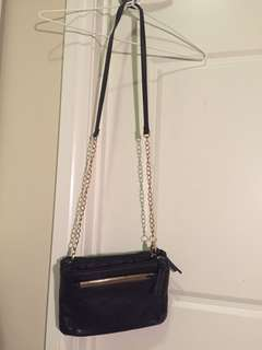 Cross body black bag with gold metal detail