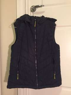 Navy puffer vest with detachable hood