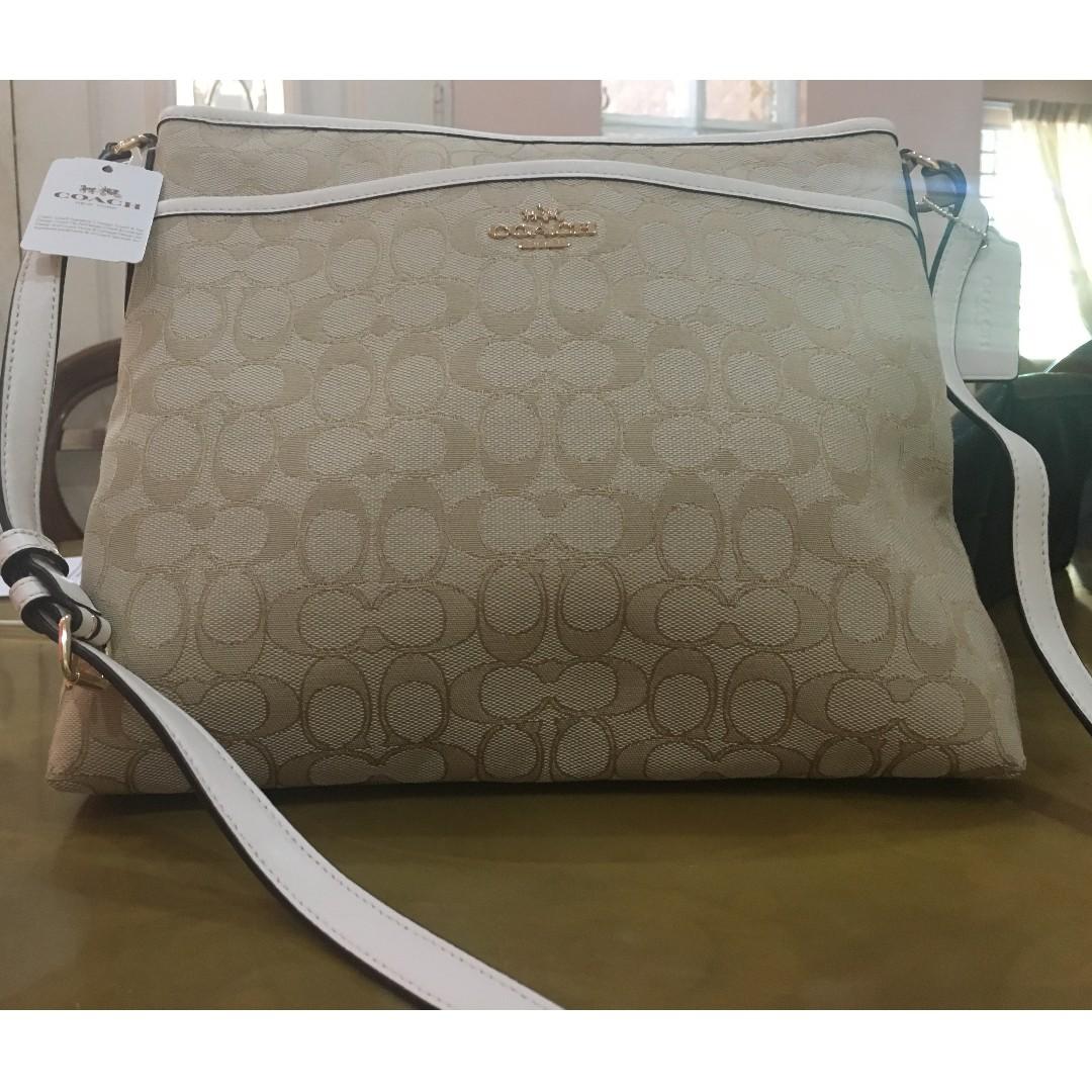... harga f1b6e a7512 amazon coach handbag signature file crossbody light  khaki womens fashion bags wallets on carousell 470ea 388a0 ... aeba3d3a0f