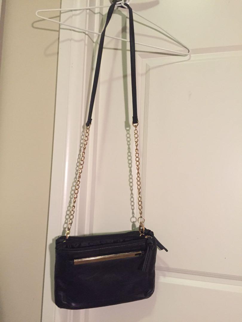 Cross body black bag with gold metal detail