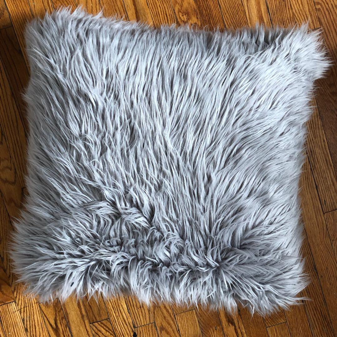 Grey furry pillow