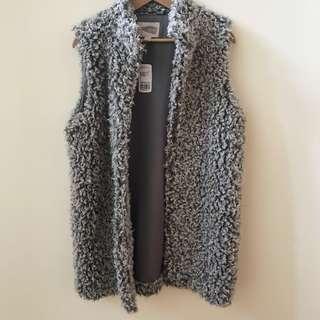 shaggy grey vest