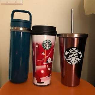 Travel mugs from starbucks and davids tea