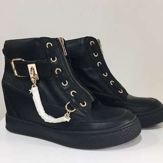 Leather wedge sneakers with chain detail