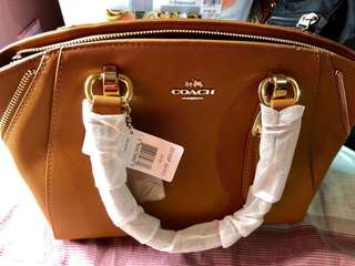 Coach 2way                                                          Details: Authentic Overruns Color - Brown Medium Type of bag w/sling  Synthetic Leather  Inclusion: Dust Bag Care Card Authenticity  See pictures to apprecite! 😍😊