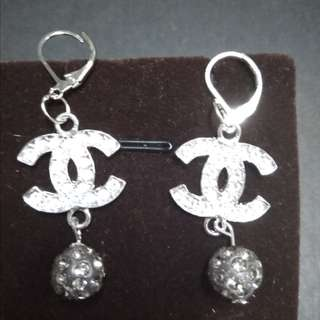 Channel inspired earings with crystal beads