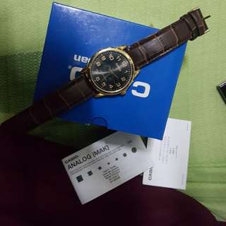 Casio black and gold dial with leather strap