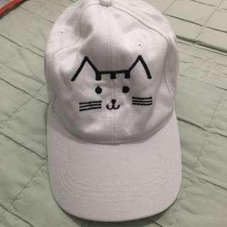 White cap (cat design)