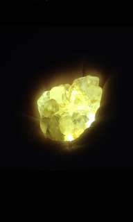 Precious stone glowing on light