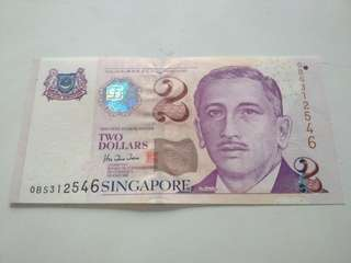 SG 2 dollars sign by HTT with 1 to 6 in the s/n.
