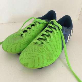 Neon green Adidas soccer shoes