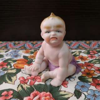 Antique porcelain baby crying figure