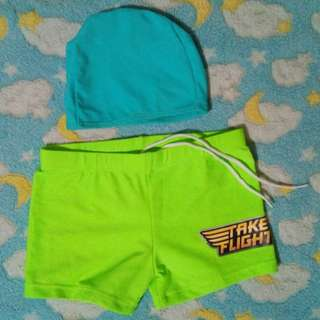Swimming trunks and cap