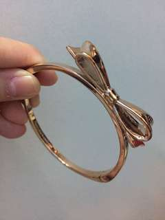 Kate Spade rose gold ribbon bangle