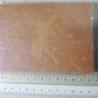Plain brown notebook