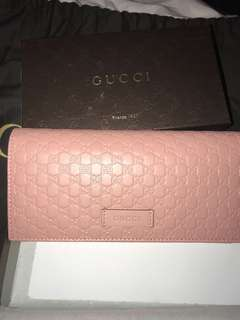 Gucci signature pink wallet