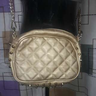 gold bag with studs