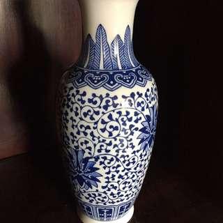Tall skinny blue vase
