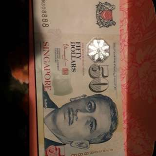 $50 note with serial 888