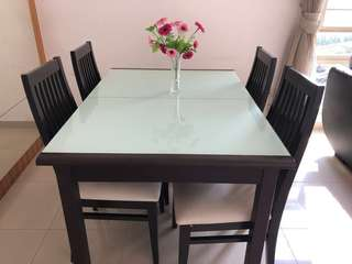 Extended Tempered glass dining table with chairs