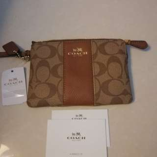 Coach caramel brown purse with leather strip