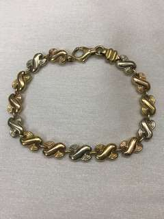 Inifinity chain link bracelet in 18 karat trigold (Rose gold, white gold and yellow gold) 10.9 grams hallmark Italy 750 * 601
