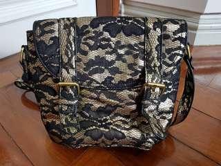 Black and gold floral shoulder bag