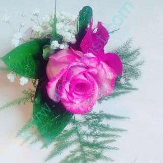 Purple roses corsages
