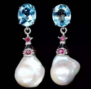 Dangling baroque pearl earring with blue topaz