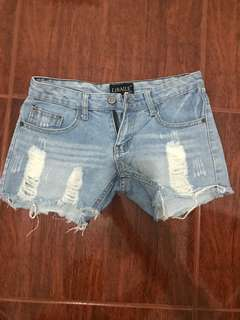 Mid waisted ripped denim shorts