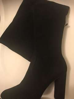 Over the knee boots by Steve Madden