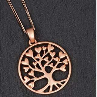 Rose gold tree of life heart necklace.