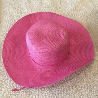 Cute pink wide brimmed hat with tie
