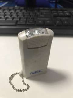 c. Early 1990s NEC keychain torchlight