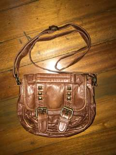 Claire's ; brown studded body bag